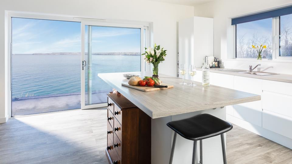 On summer days open up the large patio doors to let in the fresh air and the magical sound of the sea.
