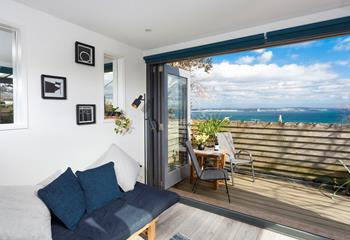 Open up the bi-fold doors and let the outside in, sea breeze drifting through the air.