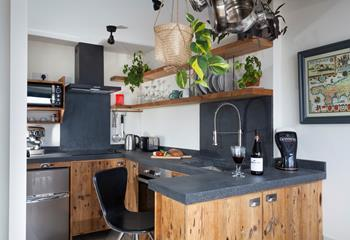 The kitchen has been thoughtfully designed and well-equipped with a selection of mod-cons for guests' use.