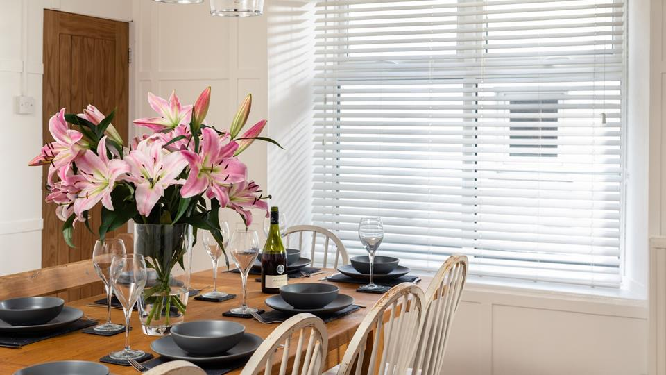 The light and spacious dining room is perfect for a family feast of home cooked meal or takeaway.