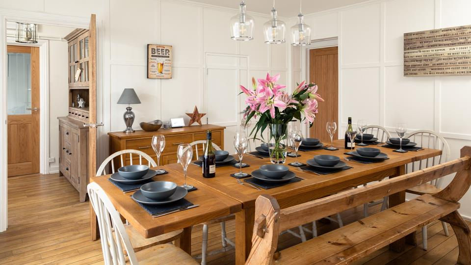 The dining room provides ample room for the whole family and is the perfect space for a special occasion.