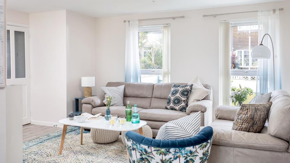 Stylish soft furnishings add a luxurious finish to the sitting room.