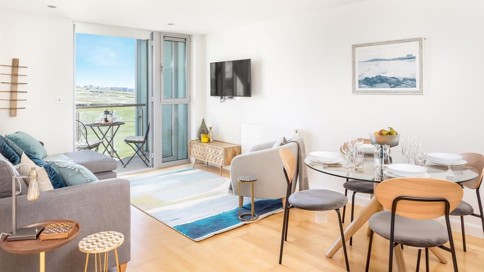 The stylish open plan living area has all you need for a self catering holiday by the sea.
