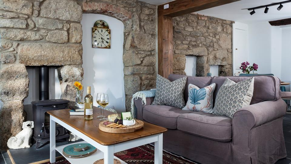 Open plan living space with woodburner, perfect for winter nights in.