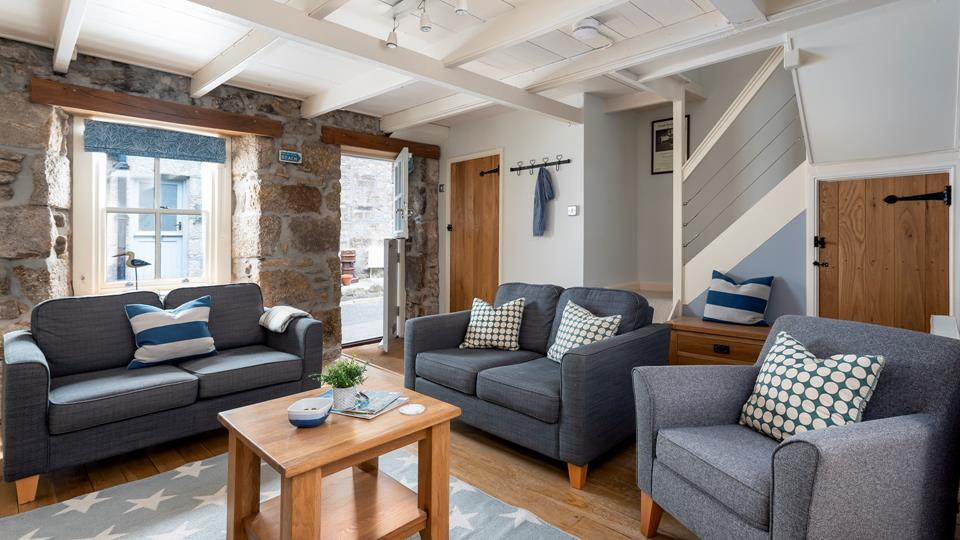 Open up the stable doors and relax with the sea air drifting into the living area.