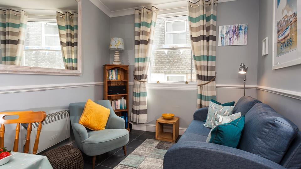 Snug and cosy, the sitting room is the perfect place to relax after a day exploring St Ives.