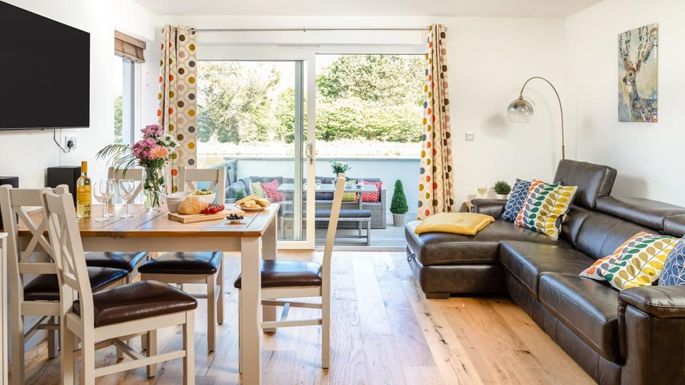 The living space unfurls onto the outside decking space creating a total canal side experience.