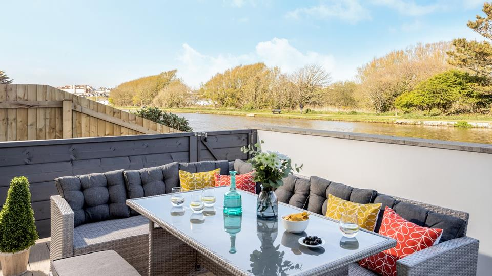Gorgeous outside living space overlooking the Bude Canal, with a private gate for access onto the tow path.
