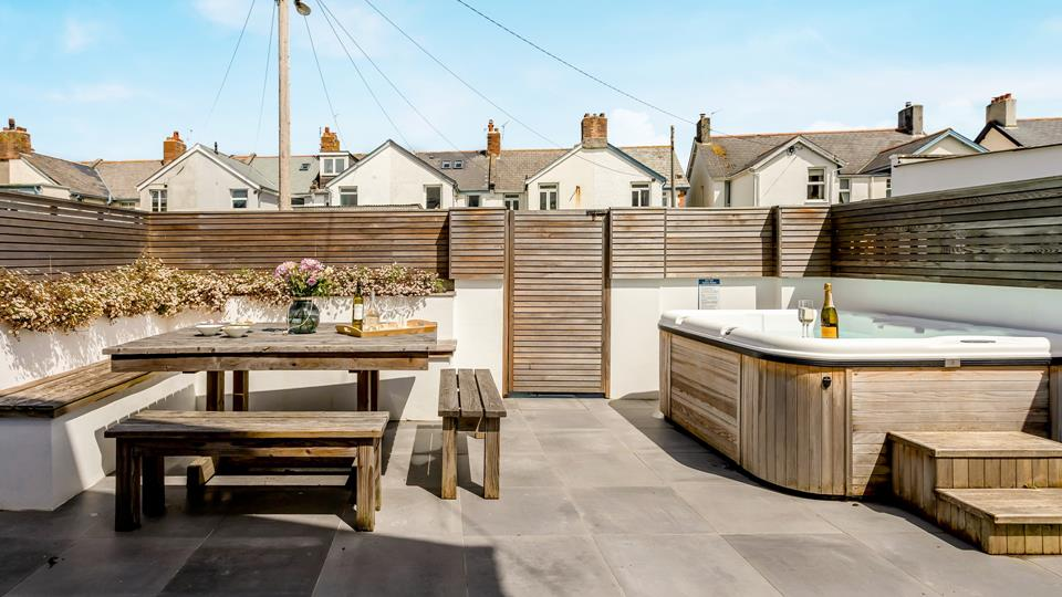 Italian porcelain tiling, and cedar wood seclusion fencing form a private and designer garden outside area, the hot tub is well-sized and provides a fabulous relaxation zone.