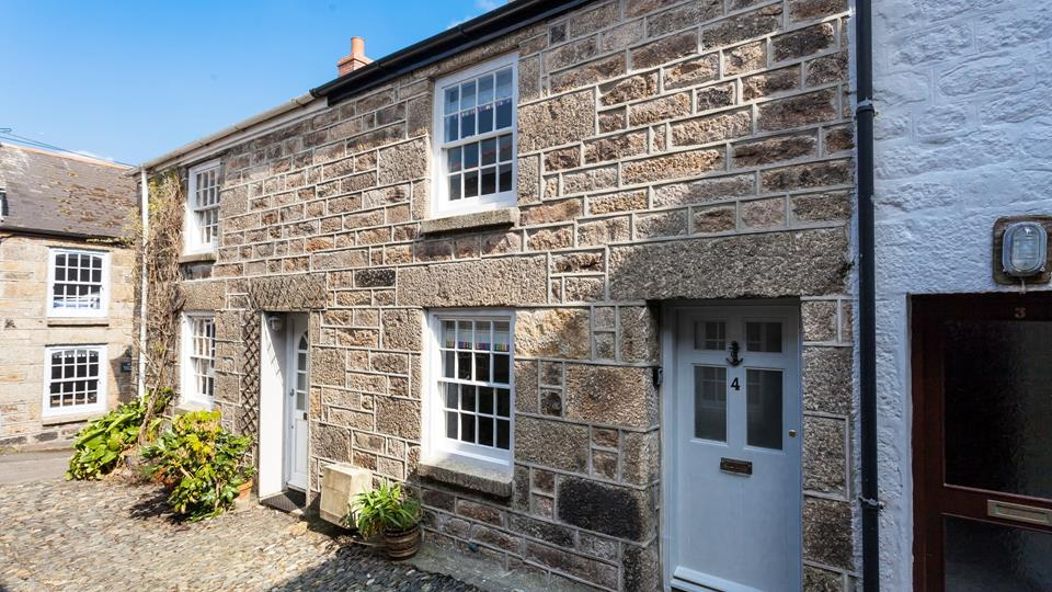 Typically Cornish, the delightful, Woodbine Cottage.