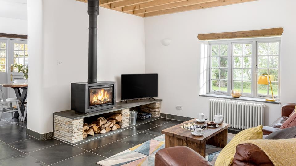 The living space is open plan with natural local slate floors, exposed beams and an elevated level woodburner perfect for an evening after exploring the surroundings.