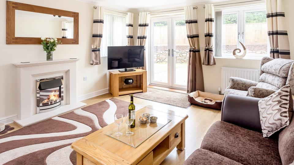 The sitting room has an electric flame effect fire which provides a warm cosy focal point, double patio door lead out to the outside area to the rear of the property.