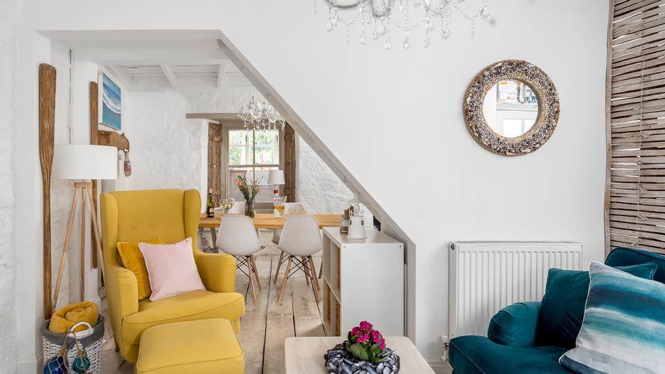 Bright whites and vibrant colours create a lovely space to relax.