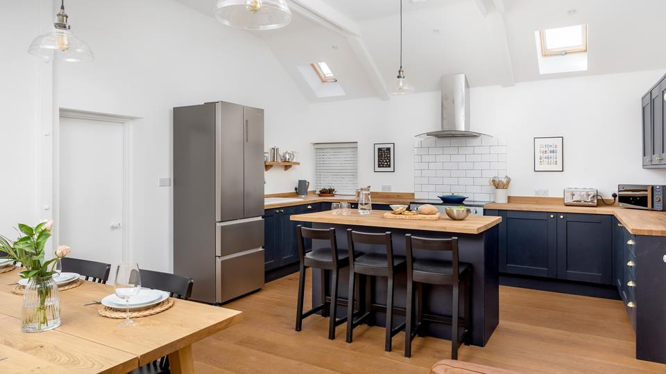 Beautifully designed, the striking modern kitchen is light, spacious and homely.