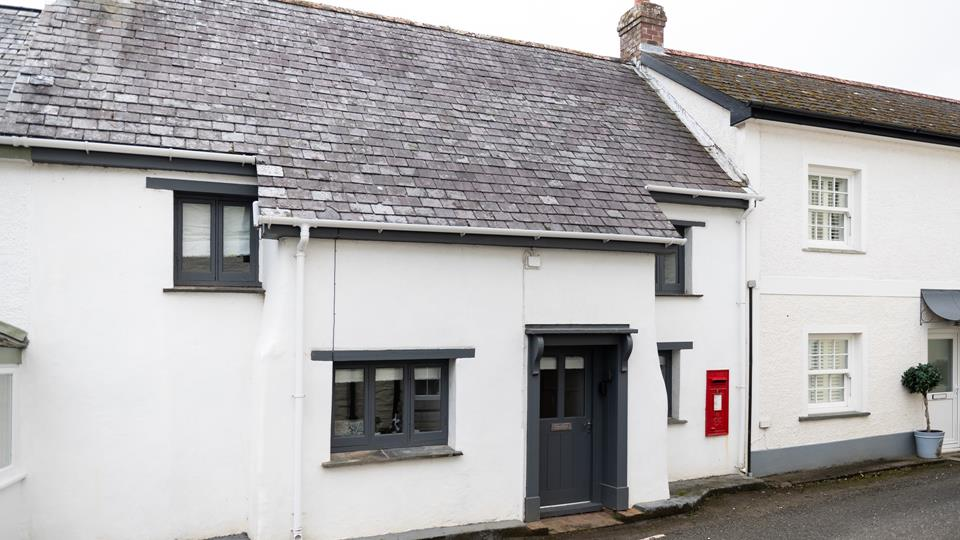 The quaint Post Box Cottage is named after its own red post box.