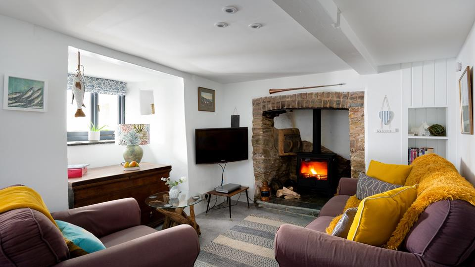 We love the feature fireplace, with granite surround, traditional wall oven and woodburner.