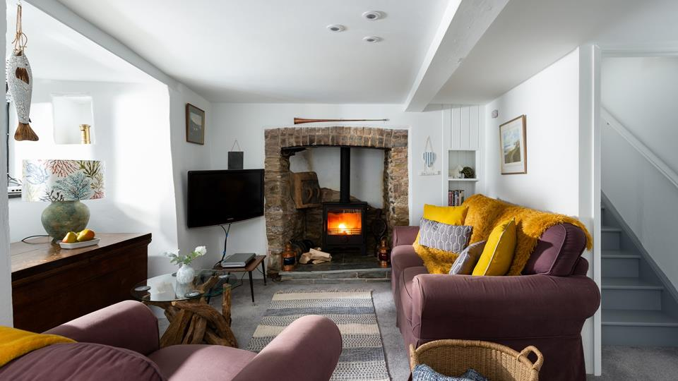 Beautifully traditional, the sitting room is cosy and comfortable, perfect for an evening in after a busy day out.