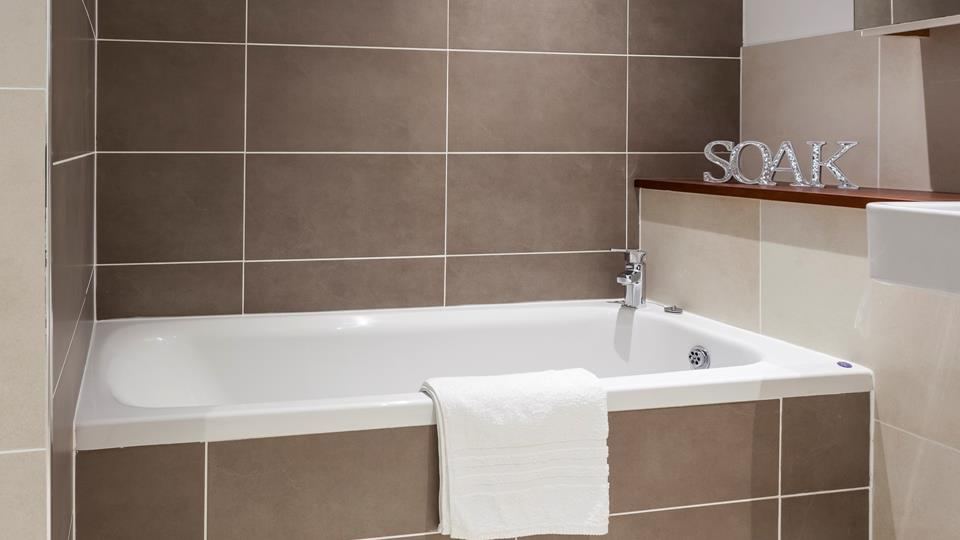 Sink into the bath tub and let any troubles melt away.