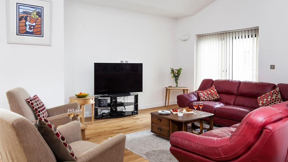 The spacious open plan living area is a great space for spending quality family time together.