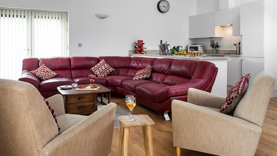 You can cook a meal and still hang out with family and friends in this sociable space.