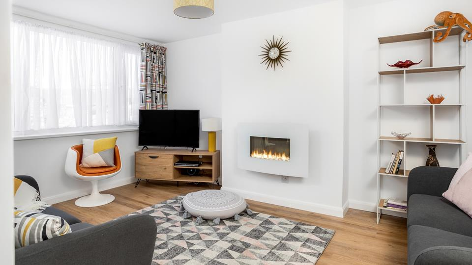 Modern, bright and comfortable, the sitting room is welcoming after a busy day out.
