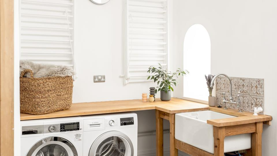 Even the utility room on the ground floor is stylish, with handy wall mounted clothes airers, as well as a tumble dryer.