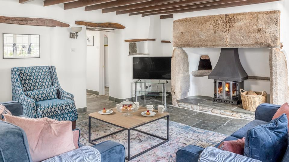 The sitting room has massive local granite fireplace with slate hearth and original cloam oven, the floor is also solid natural slate and the original exposed lintels above the doorway and small shelf space are beautiful.