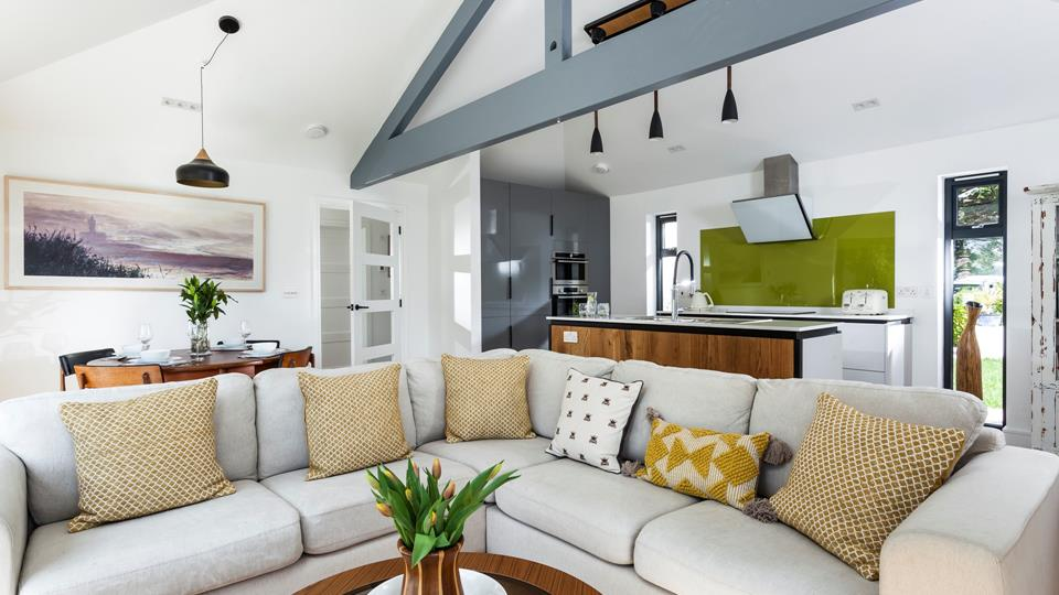 The living area has a real wow factor with its vaulted ceiling and stylish furniture.