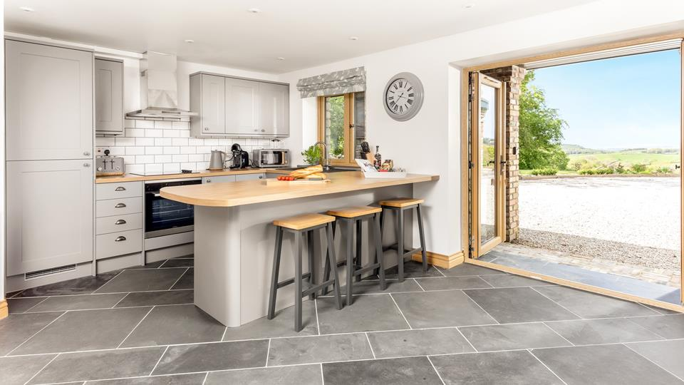 The kitchen area opens out onto the circular driveway and has stunning views across miles of rolling countryside and the Atlantic ocean.