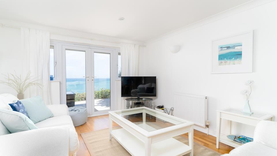 The sitting room is perfect for relaxing in, while still being able to watch over the blue waters.