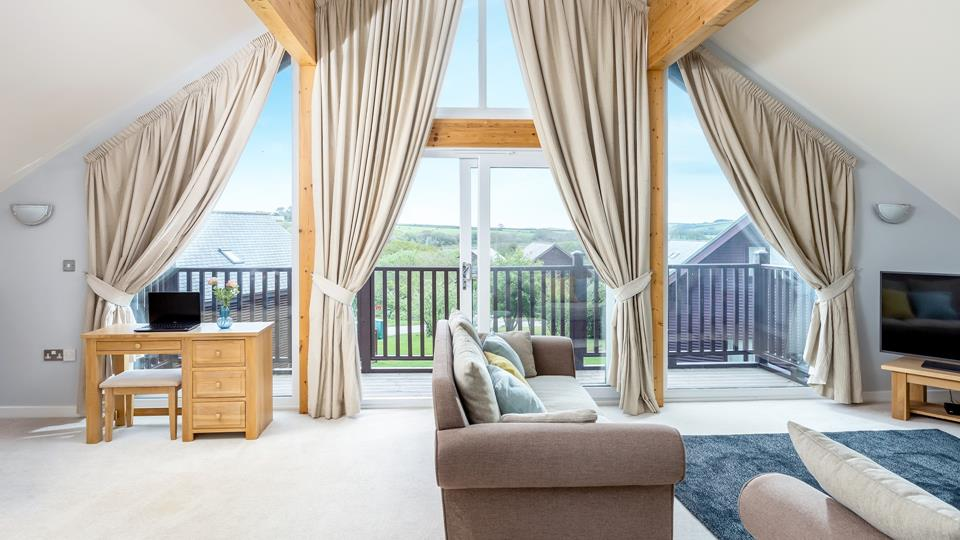 Relax in this spacious lounge and enjoy the countryside views.