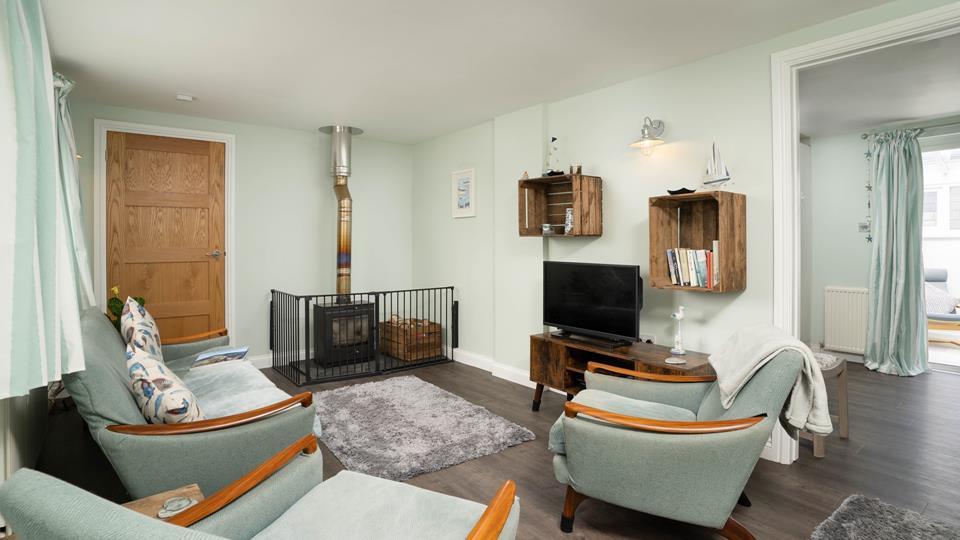 Light the woodburner on cooler evenings. Door goes through to ground floor bedroom with en suite shower room.