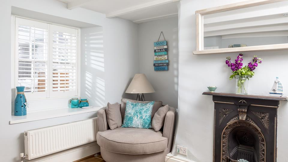 Step into the entrance porch, which has a beautiful feature only fire place, helping to retain this traditional feel of this old fisherman's cottage.