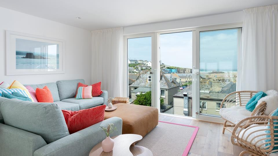The living space is on the third floor, with open plan living and views of Perranporth beach.