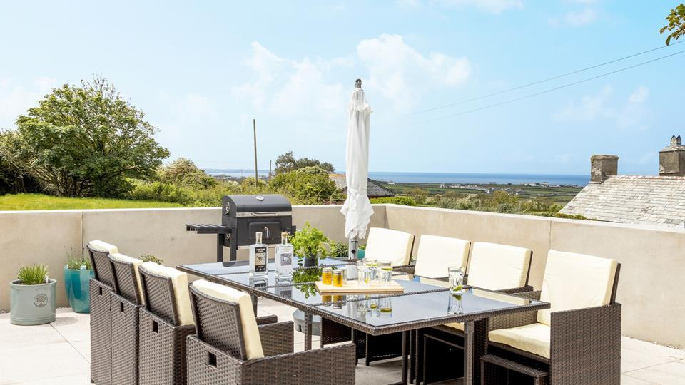 BBQ with a view. enjoy eating outside with fantastic sea and countryside views, light the Chiminea on the chillier evenings