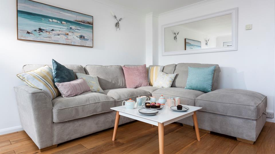Nestle into the sumptuous sofa after a long day exploring all Cornwall has to offer.