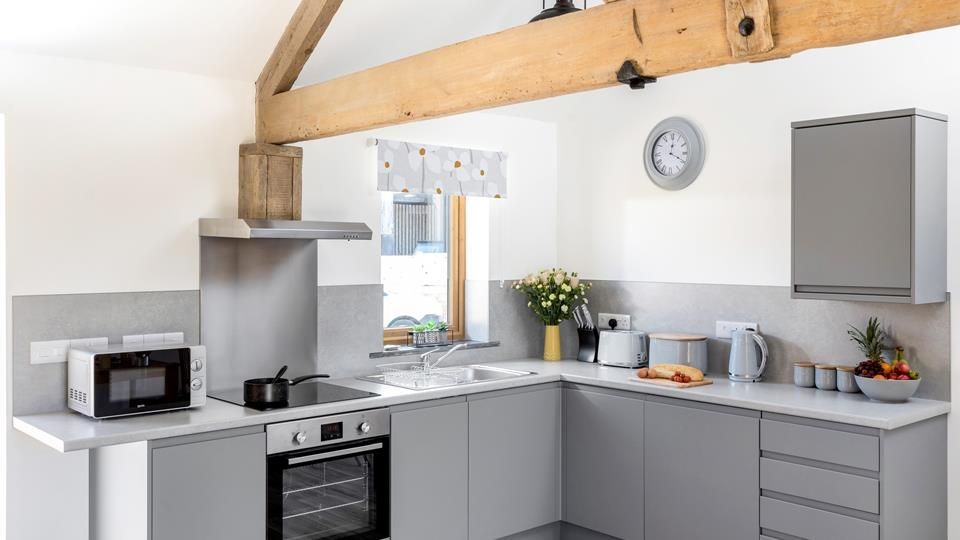 The modern kitchen is wonderfully spacious and equipped with plenty of appliances to make cooking a dream.