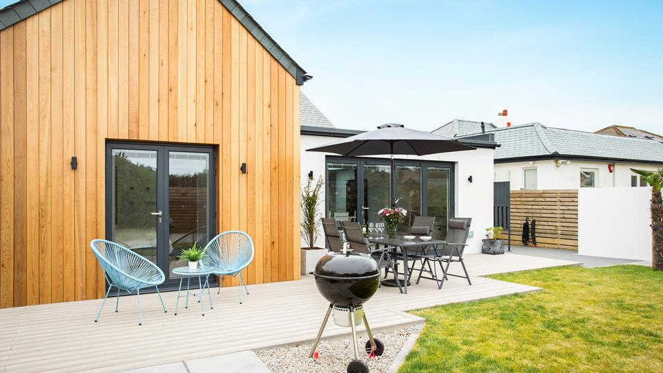 The rear area has plenty of outside lighting and everything you need to enjoy al fresco life from an outside shower, hot tub, seating, BBQ and there is even a hose and outside tap to deal with after beach salty toes!